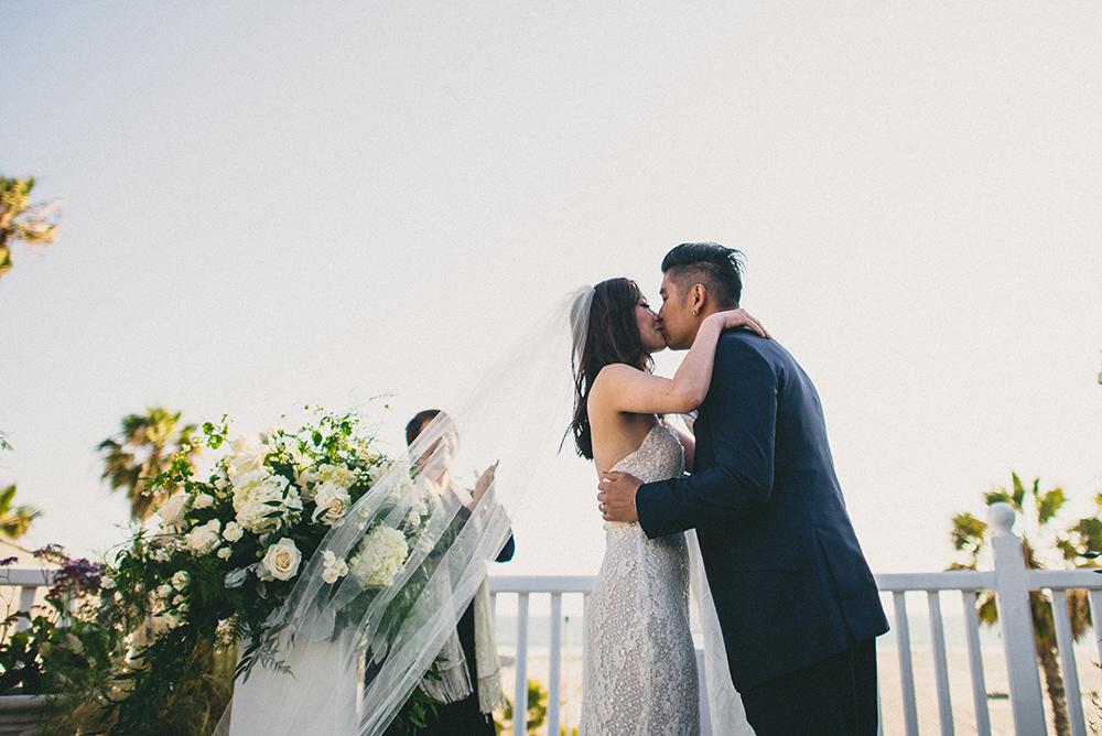Kiss Wedding Shutters on the beach